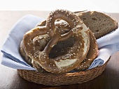 Soft pretzels and bread in bread basket