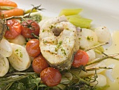 Grilled sea bass cutlet on roasted vegetables