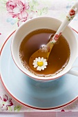Chamomile tea in cup with spoon