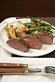 Beef steak with potato wedges, beans & bacon