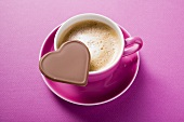 Cup of cappuccino with chocolate heart