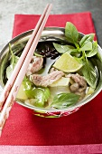 Turkey and lemon grass soup with limes and Thai basil (Asia)