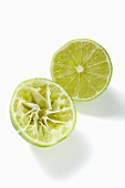 Two lime halves, one squeezed