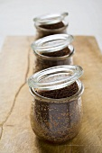 Three chocolate puddings, baked in jars