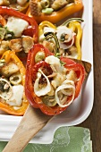 Peppers stuffed with white bread, olives, onions
