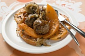 Meatballs with roasted pumpkin slices on plate