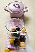 Plums, mirabelles, sugar, jam jar, pan
