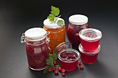 A selection of jams & jelly in jars, redcurrants & leaves