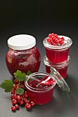 Raspberry jam and redcurrant jelly, redcurrants, leaves