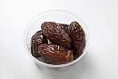 Dried dates in plastic dish