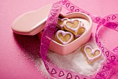 Small heart-shaped biscuits for Valentine's Day in sugar bowl