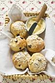 Sugared raisin scones & small dish of butter in bread basket