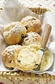 Sugared raisin scones with butter in bread basket