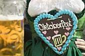 Woman with Lebkuchen heart at Oktoberfest
