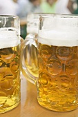 Several litres of beer on table at Oktoberfest
