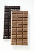 Two bars of chocolate: dark chocolate and milk chocolate