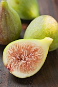 Three whole figs and one half fig (close-up)