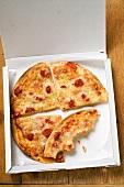 Pizza Margherita, in slices in pizza box
