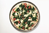 Spinach, tomato and cheese pizza (unbaked)