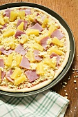 Hawaiian pizza with ham and pineapple (unbaked)
