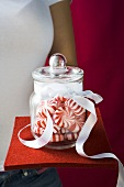 Hand holding a jar of Starlite Mints (USA)