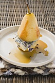 Poached pear with blue cheese and lavender flowers