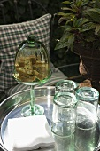 Cantuccini and empty glasses on a tray in the open air