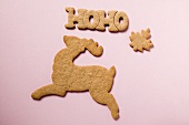 Gingerbread biscuits for Christmas (reindeer, word, leaf)