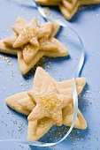 Pastry stars with sugar and blue ribbon