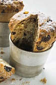 Chocolate panettone, a piece cut, in baking tin