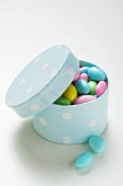 Coloured sugared almonds in blue box