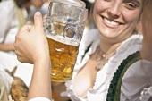 Women clinking two litres of beer together (Oktoberfest, Munich)