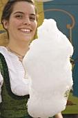 Woman holding candyfloss (Oktoberfest, Munich)