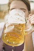 Woman drinking a litre of beer (Oktoberfest, Munich)