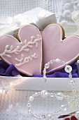 Two heart-shaped Christmas biscuits to give as a gift