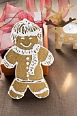 Gingerbread man in front of Christmas gifts