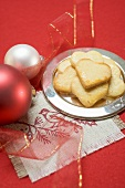 Heart-shaped Christmas biscuits on silver plate