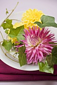 Summer table decoration of dahlias and ivy
