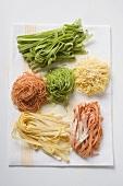Home-made coloured pasta on tea towel