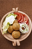 Falafel (chick-pea balls) with tomatoes and yoghurt dip