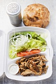 Döner kebab with salad in lunch box