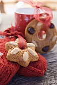 Gingerbread tree ornaments, woollen mittens and cup