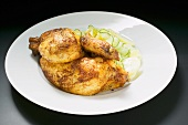 Half a roast chicken with potato and cucumber salad