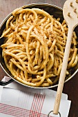Macaroni with mince sauce in pan