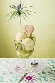 Ice cream sundae with vanilla ice cream and kiwi fruit