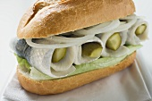 Herring, onions and gherkins in bread roll