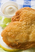 Breaded fish fillet with mayonnaise (close-up)