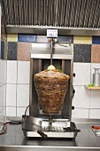 Döner kebab on spit in the kitchen of a snack bar