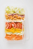 Iceberg lettuce, ham, cheese, egg & vegetables in plastic tray