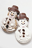 Two gingerbread snowman biscuits